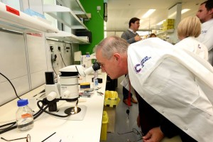 John in one of the laboratories, and with researchers and politicians - including Stephen Metcalfe MP